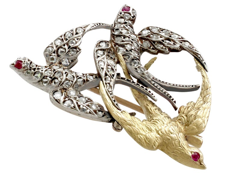An exceptional, fine and impressive antique 0.55 Ct diamond and 0.04 Ct ruby, 21k yellow gold and silver set swallow brooch; part of our antique diamond jewelry and estate jewelry collections.  This exceptional Victorian swallow brooch has been
