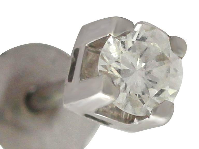 A fine and impressive pair of vintage 0.25 carat diamond and 18 karat white gold stud earrings; part of our diverse vintage jewelry and estate jewelry collections.  These fine and impressive vintage diamond stud earrings have been crafted in 18k