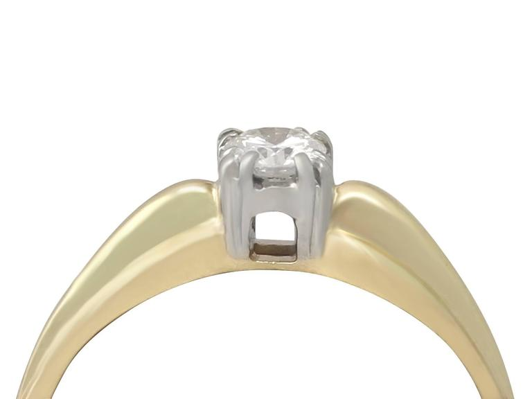 A fine and impressive 0.28 carat diamond and 14 karat yellow gold, 14 karat white gold set solitaire ring; part of our diverse diamond jewelry and estate jewelry collections  This fine and impressive diamond solitaire ring has been crafted in 14k
