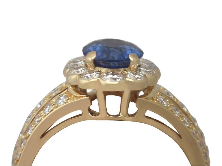 A fine and impressive 1.50 carat blue sapphire and 0.80 carat diamond (total), 18k yellow gold dress ring; part of our diverse jewellery and estate jewelry collections  Description  This fine and impressive sapphire and diamond cocktail ring has