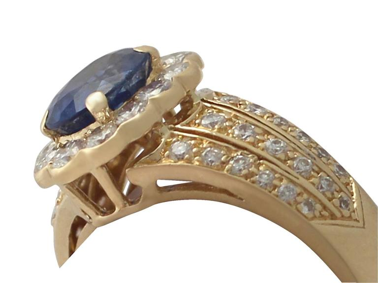 Round Cut 1980s 1.50 Carat Sapphire and Diamond Yellow Gold Cocktail Ring For Sale