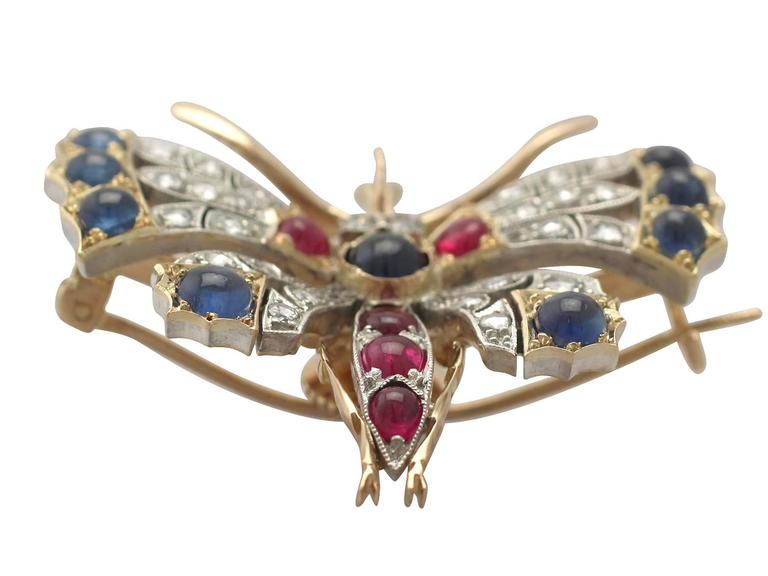 A stunning, fine and impressive 1.46 carat diamond, 2.62 carat sapphire and 1.10 carat ruby and 18 karat yellow gold butterfly brooch with a silver setting; part of our diverse antique jewellery and estate jewelry collections  This impressive