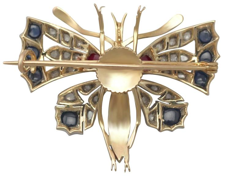 Women's Diamond and Sapphire, Ruby and 18k Yellow Gold Butterfly Brooch For Sale