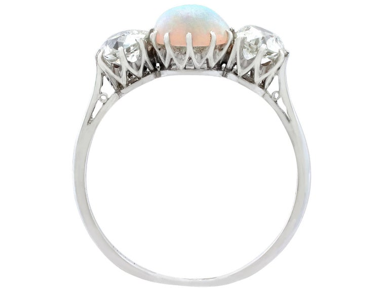 Women's Antique Opal and 1.08 Carat Diamond Gold Trilogy Ring For Sale