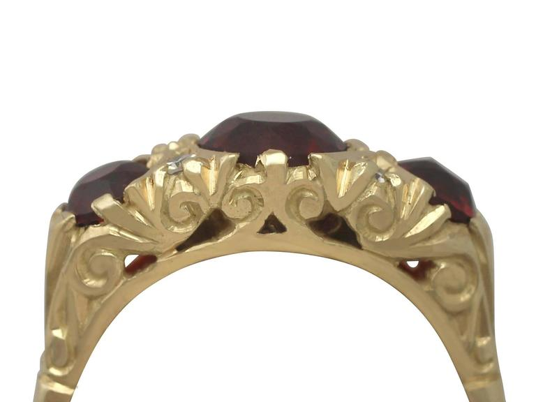 A fine and impressive 2.05 carat garnet and 0.08 carat diamond, 18 carat yellow gold dress ring; part of our diverse vintage jewellery collections.  This fine and impressive vintage garnet and diamond ring has been crafted in 18 ct yellow gold.  The