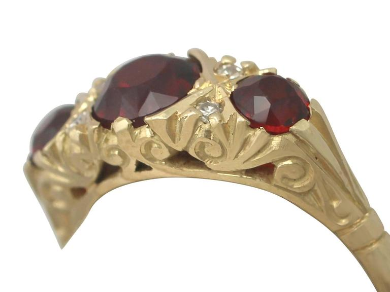 Round Cut 1970s 2.05 Carat Garnet and Diamond Yellow Gold Cocktail Ring For Sale
