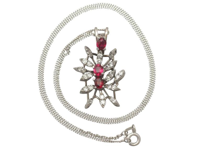 A fine and impressive vintage 0.88 carat ruby and 0.69 carat diamond, 18 carat white gold pendant; part of our diverse vintage jewellery collections.  This fine and impressive ruby and diamond pendant has been crafted in 18 ct white gold.  The