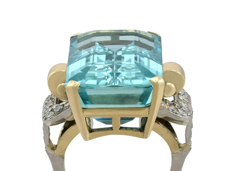 A stunning vintage 28.80 carat aquamarine and 0.66 carat diamond, 18 carat yellow and white gold cocktail ring; part of our diverse vintage jewellery collections.  This stunning, fine and impressive large aquamarine cocktail ring has been crafted in