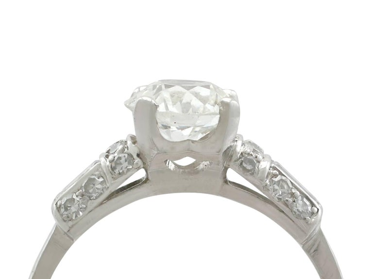A stunning vintage 1.09 carat diamond and platinum solitaire style engagement ring; part of our diverse diamond jewellery collections.  This stunning, fine and impressive vintage diamond solitaire ring has been crafted in platinum.  The pierced
