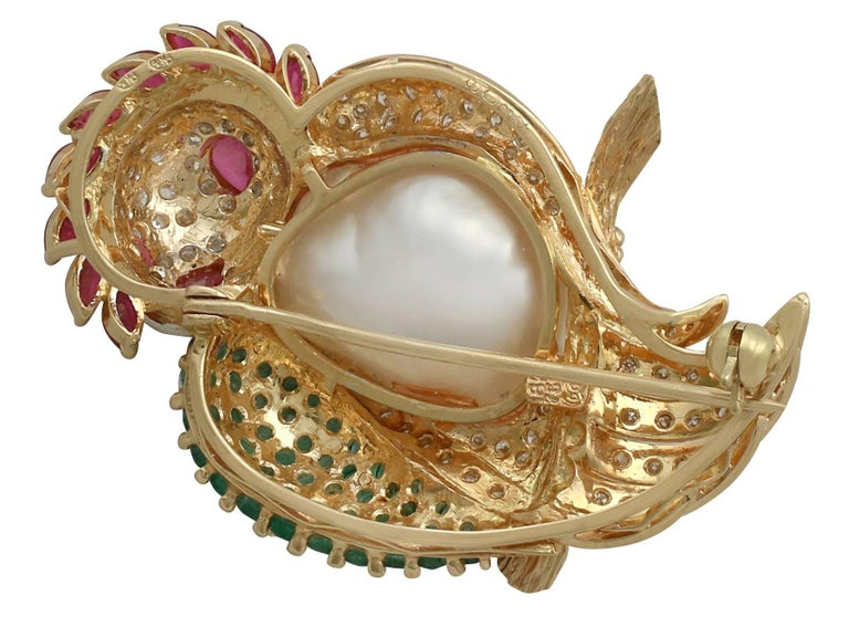 1980s Pearl 1.76 Carat Ruby 1.30 Carat Emerald & 1.15 Carat Diamond Gold Brooch For Sale 1
