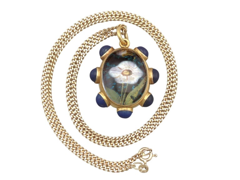 A stunning and exceptional rock crystal, lapis lazuli and 18k yellow gold locket / pendant by Garrard & Co; part of our diverse antique jewellery collections.  This stunning, exceptional, fine and impressive rock crystal pendant has been crafted in