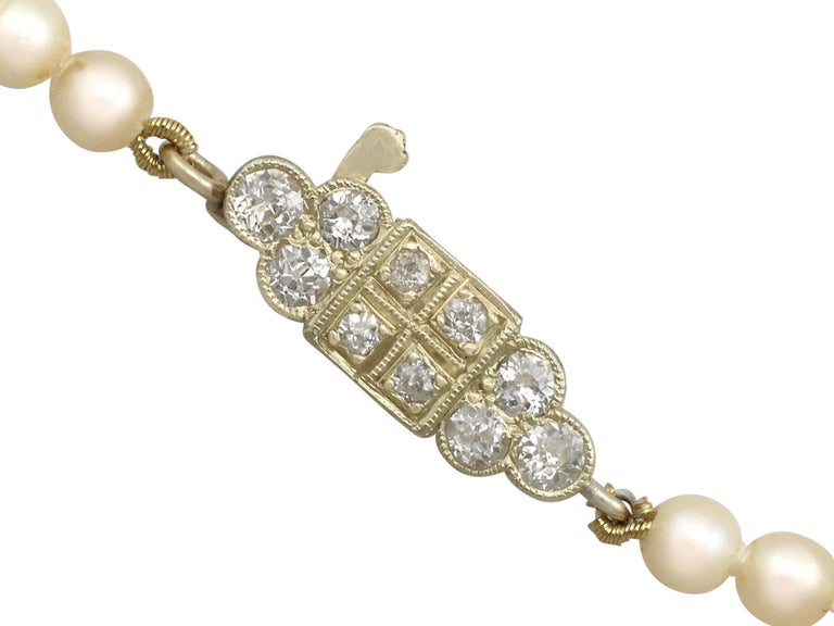 Women's Single Strand Pearl Necklace 0.56 Carat Diamond 15 Karat Gold Clasp For Sale