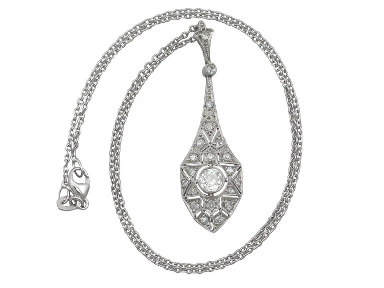 A stunning antique 1920's Art Deco 0.94 carat diamond and 18 carat white gold pendant; part of our diverse diamond jewellery and estate jewelry collections.  This stunning, fine and impressive antique Art Deco necklace has been crafted in 18k white