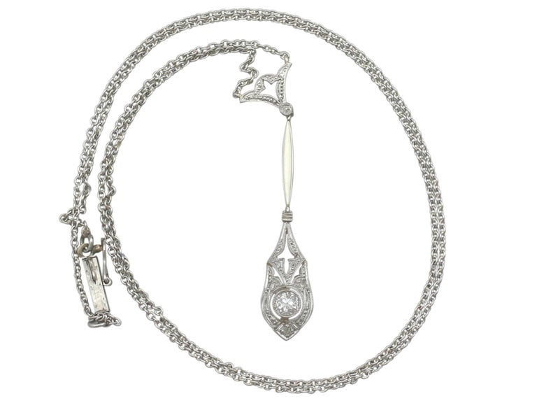 A fine and impressive 0.19 carat diamond and 14k yellow gold, 14kwhite gold set necklace with platinum chain; part of our diverse antique jewellery collections.  This fine and impressive antique diamond drop necklace has been crafted in 14k yellow