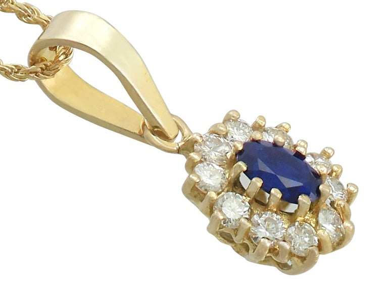Oval Cut 1980s Sapphire and Diamond 18k Yellow Gold Cluster Pendant  For Sale