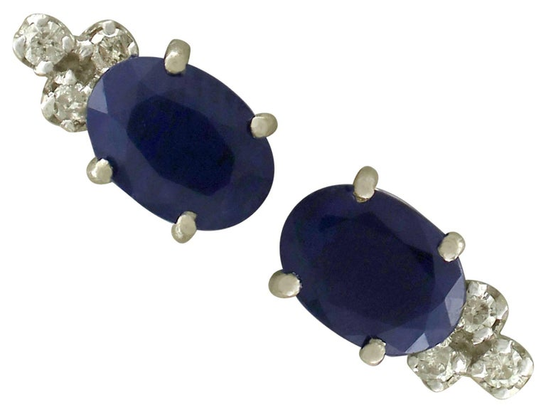 An impressive pair of 1.82 carat sapphire and 0.09 carat diamond, 18 carat white gold stud earrings; part of our diverse antique jewellery and estate jewelry collections.  These fine and impressive blue sapphire and diamond stud earrings have been