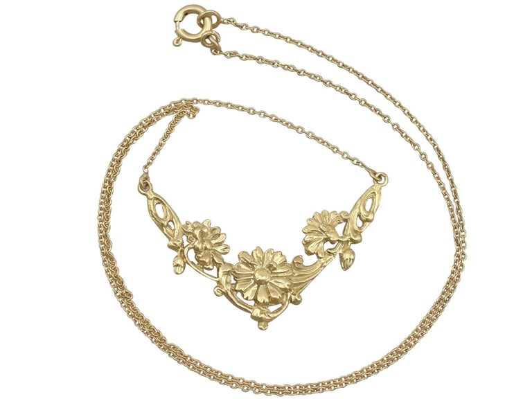 An impressive antique 1920's French 18 karat yellow gold necklace; part of our diverse antique jewellery and estate jewelry collections.  This fine and impressive antique French necklace has been crafted in 18k yellow gold.  The feature setting has