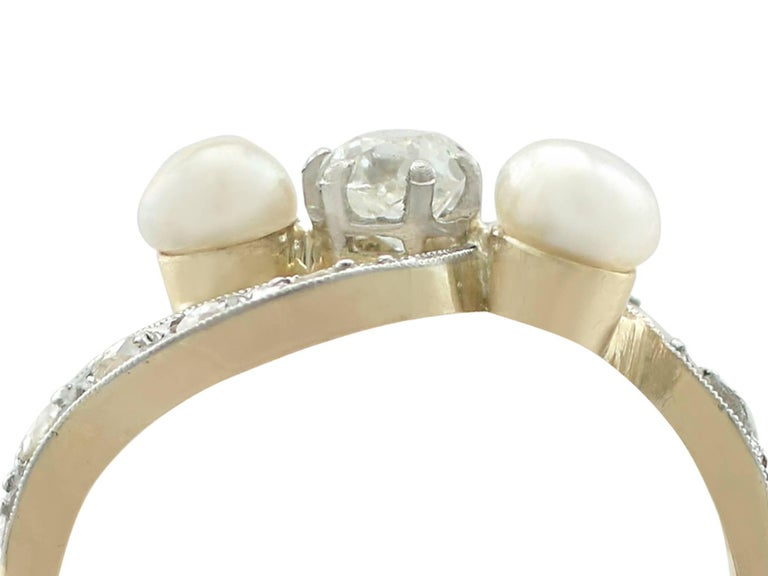 An impressive antique French seed pearl and 0.45 carat diamond, 18 karat yellow gold and 18 karat white gold set twist ring; part of our diverse antique jewellery collections.  This fine and impressive pearl and diamond twist ring has been crafted