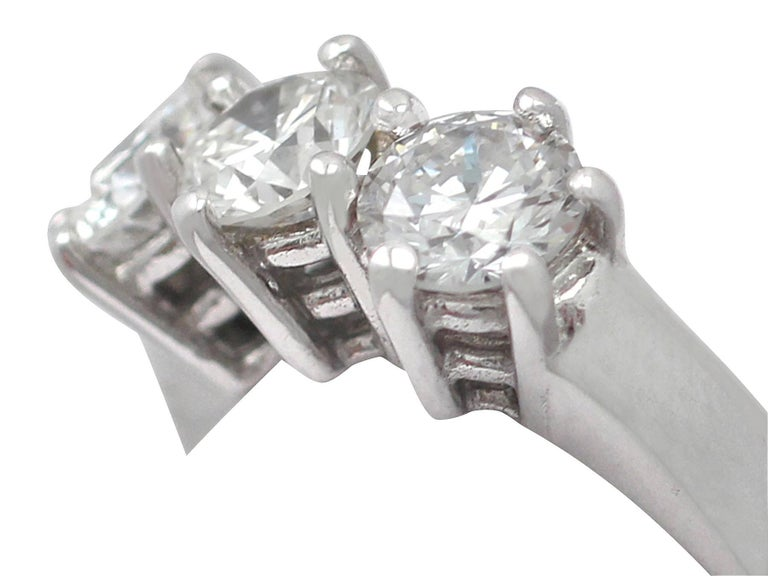 Round Cut 1980s 1.18 Carat Diamond and 18 Karat White Gold Trilogy Ring For Sale