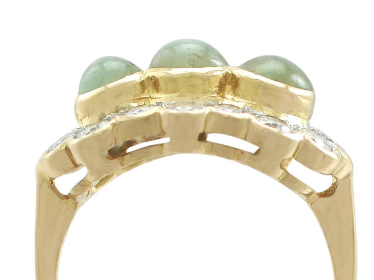 A stunning vintage 2.19 carat cat's eye chrysoberyl and 0.96 carat diamond, 18 carat yellow and white gold dress ring; part of our diverse gemstone jewellery collections.  This stunning, fine and impressive vintage cat's eye chrysoberyl ring has