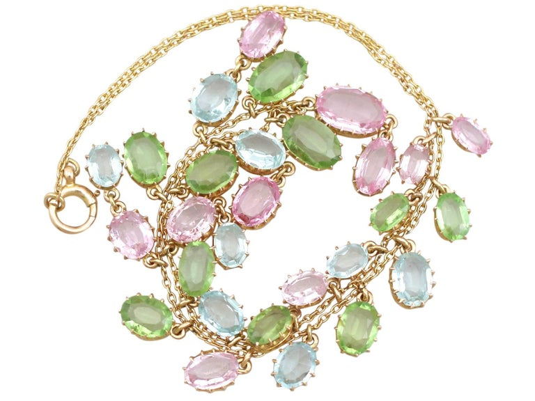 A stunning antique 25.87 carat (total) rose quartz, peridot and aquamarine, 18 ct and 10 ct yellow gold necklace; part of our diverse antique jewellery collections.  This stunning, fine and impressive antique multi gem necklace has been crafted in