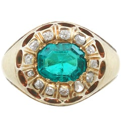 1900s 1.22 Carat Emerald and Diamond Yellow Gold Cocktail Ring