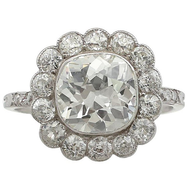 1910s 4.47 Carat Diamond and Platinum Cluster Ring