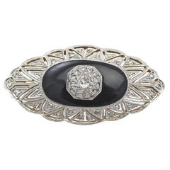 Art Deco 0.57 Carat Diamond and Black Onyx, 15 Karat Gold Brooch, circa 1930