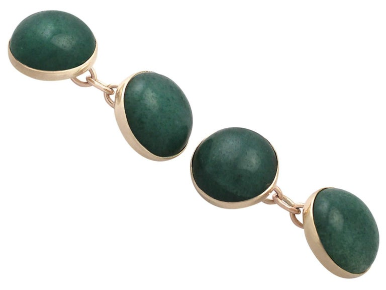 A fine and impressive pair of antique moss agate and 9 karat yellow gold cufflinks; an addition to our men's jewelry and estate jewelry collections  These fine and impressive moss agate cufflinks have been crafted in 9k yellow gold.  The cufflinks