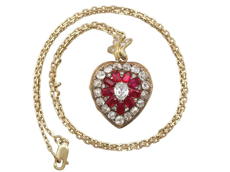 An exceptional, fine and impressive antique Victorian 4.55 carat diamond and synthetic ruby, 18 karat yellow gold pendant/locket; part of our Victorian jewelry collections  This exceptional and stunning antique Victorian locket has been crafted in