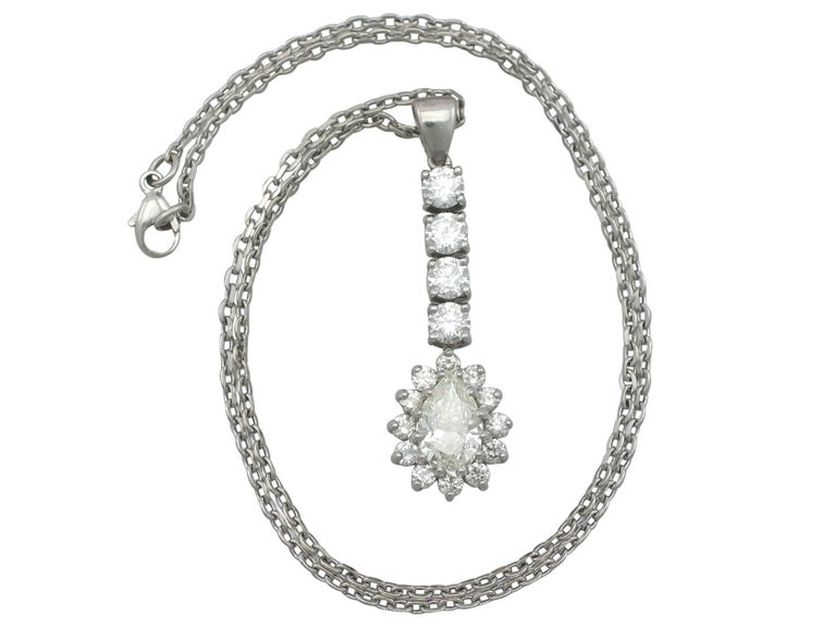 A stunning, fine and impressive contemporary 4.13 carat diamond and 18 karat white gold pendant; part of our diverse contemporary jewelry collection  This stunning contemporary diamond cluster pendant has been crafted in 18k white gold.  The feature