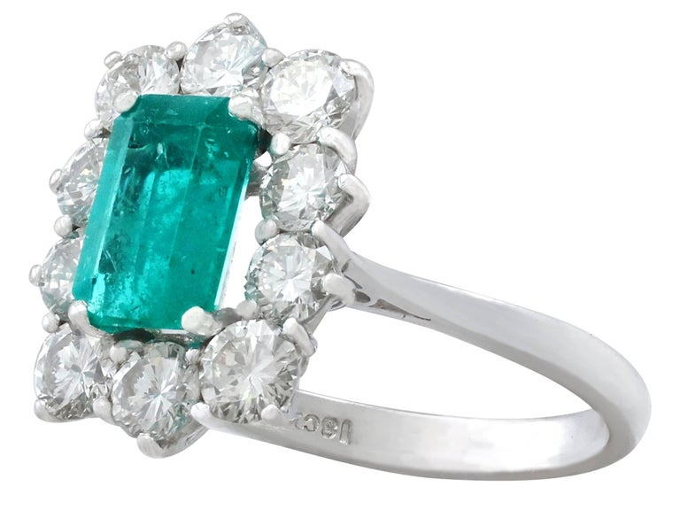 Women's 1.57 Carat Emerald and 1.72 Carat Diamond Cluster Engagement Ring For Sale