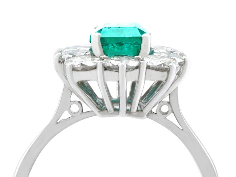 A stunning vintage 1.57 carat natural emerald and 1.72 carat diamond, 18 karat white gold, platinum set cluster ring; an addition to our vintage jewelry collections  This stunning, fine and impressive emerald cluster ring has been crafted in 18k