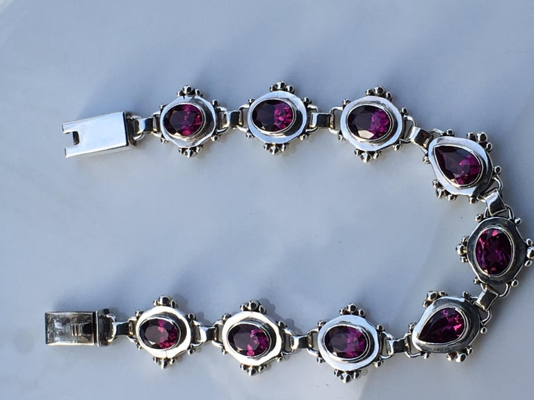 Garnet Bracelet set in sterling silver is one of a kind handcrafted Bracelet.Approx 16 Carat Garnet  Bracelet is 7.5 Inches long. Total weight of Bracelet is 23.40 Gram.Total number of Garnet is nine, Seven stone they are oval size 6 MM X 8 MM and