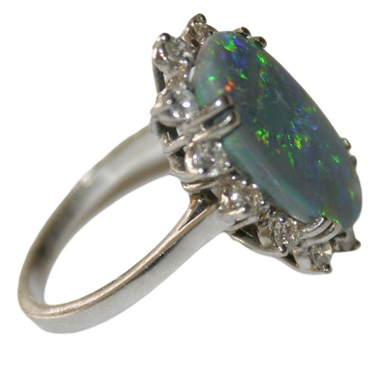 Oval Cut 14 Karat White Gold Ladies Australian Black Opal and Diamond Cocktail Ring For Sale