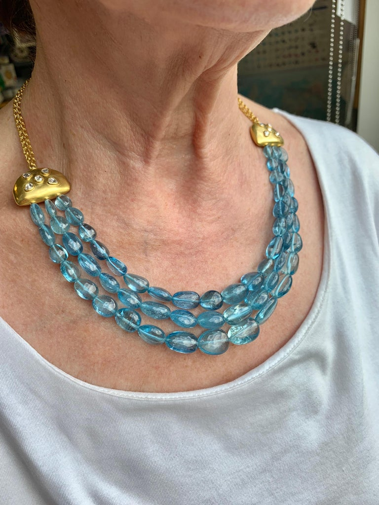 Important Aquamarine diamond and gold necklace, of Indian inspiration. Aquamarine beads are of beautiful natural color 337 carats with very white rose cut diamonds 1.55 carats. Necklace is entirely hand crafted in 22 Karat gold. Hand made in NY, one