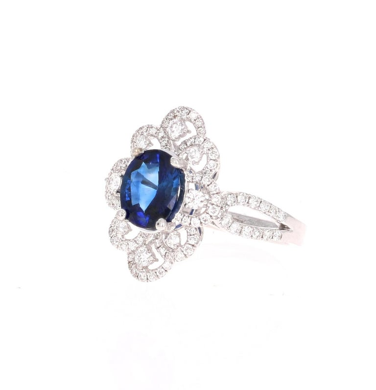 Beautiful Sapphire Diamond ring with an intricate setting!   This ring has a Blue Sapphire that weighs 1.99 Carats and is GIA Certified. The Sapphire is a natural Blue Oval Cut with indications of heating. The GIA Certificate Number is: