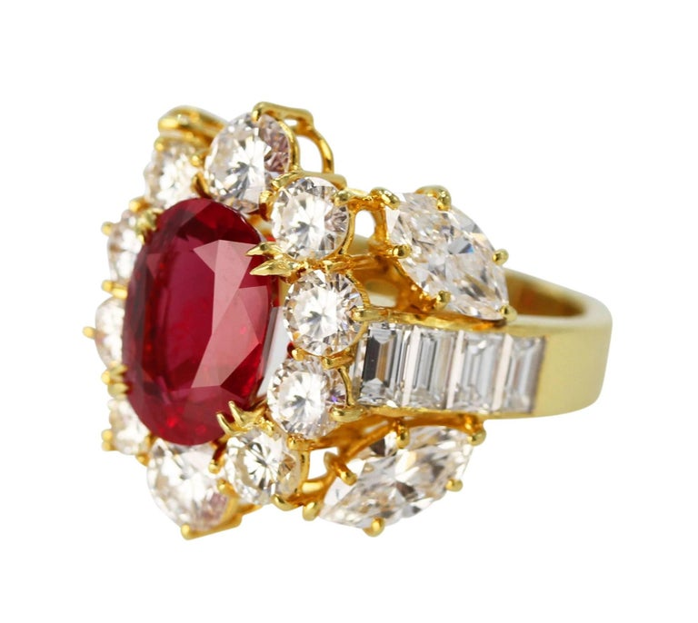 18 Karat Yellow Gold, Ruby and Diamond Ring • Signed Larry 750 • Oval ruby weighing 4.24 carats • GIA report stating Thai origin, heated • 10 round, 4 marquise-shaped and 8 baguette diamonds approximately 4.30 carats • Size 6 1/4, gross