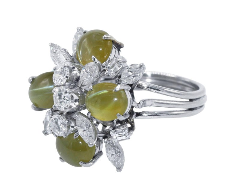 Platinum, Cat's-Eye Chrysoberyl and Diamond Ring • Stamped PLAT with indistinct maker's mark • 4 cabochon cat's-eye chrysoberyls weighing approximately 10.00 carats • 3 round diamonds approximately 0.50 carat, 4 baguette diamonds approximately