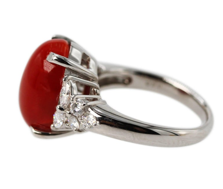 """Platinum, Red Coral and Diamond Ring • Stamped PT900, D0.50 • Oval cabochon """"ox blood red"""" coral approximately 13.9 by 10.0 mm. • 4 marquise and 6 round diamonds approximately 0.50 carat • Size 5 3/4, gross weight 9.3 grams"""