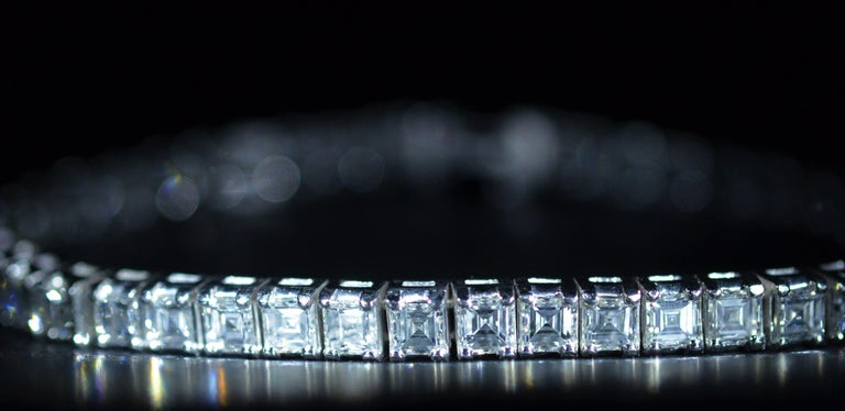 Impressive diamond line bracelet set with 15.84 carats of Asscher cut (square emerald cut or Carre Cut) diamonds. The diamonds have an approximate Gemological Institute of America clarity grade ranging from vvs1 to vs1 and a color grade of G. The
