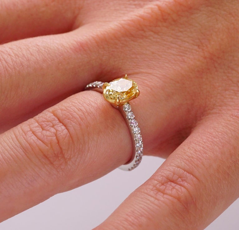 Contemporary Fancy Yellow 1.12 Carat Oval Cut Diamond Engagement Platinum Ring For Sale