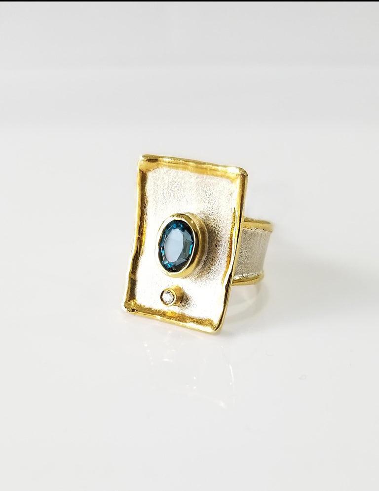 Contemporary Yianni Creations 1.25 Carat Blue Topaz Diamond Fine Silver 24 Karat Gold Ring For Sale