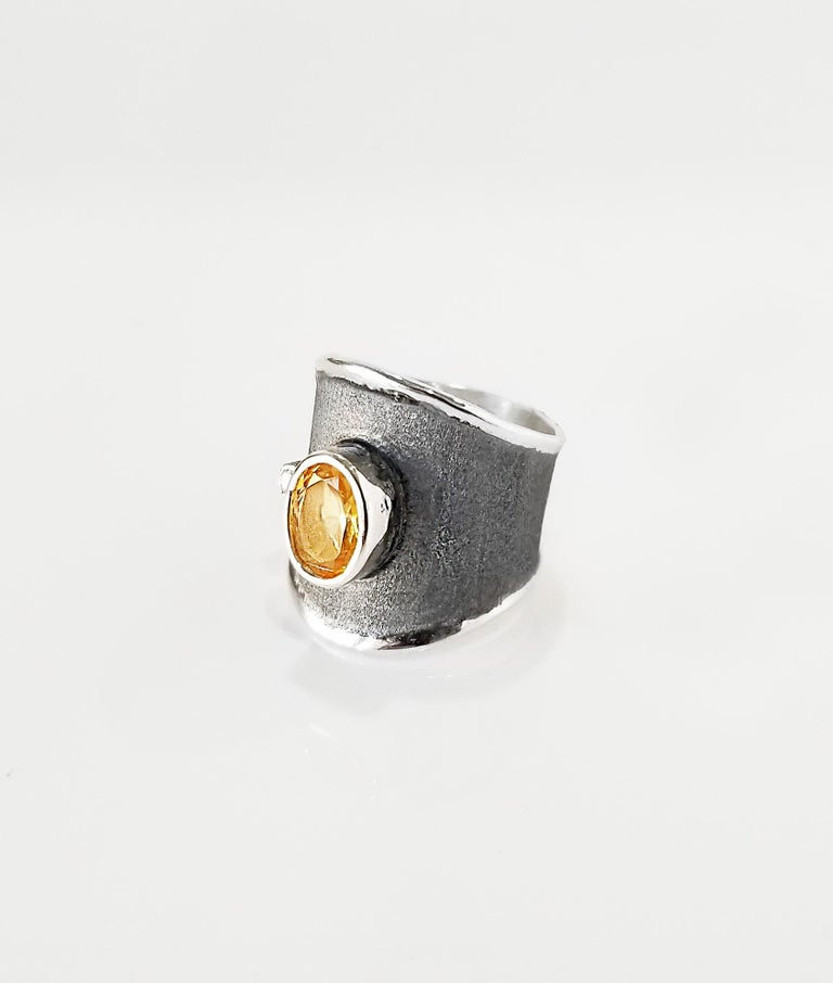 Yianni Creations Hephestos Collection 100% Handmade Artisan Ring from Fine Silver. Ring features 1.25 Carat Citrine and 0.03 Carat Brilliant cut Diamond contrasting on unique oxidized Rhodium background. Gems get complemented by unique techniques of