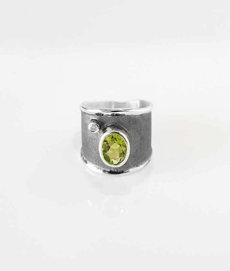 Yianni Creations Hephestos Collection 100% Handmade Artisan Ring from Fine Silver. Ring features 1.35 Carat Peridot and 0.03 Carat Brilliant cut Diamond contrasting on unique oxidized Rhodium background. Gems get complemented by unique techniques of