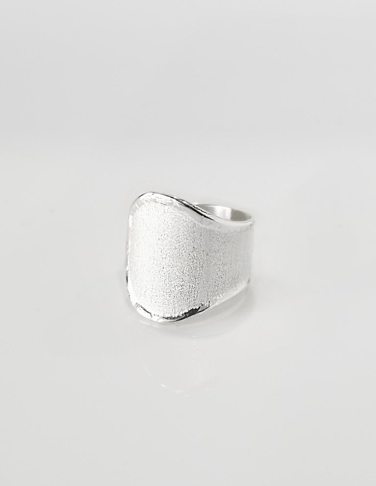 Yianni Creations Ammos Collection 100% Handmade Artisan Ring from Fine Silver featuring unique techniques of craftsmanship - brushed texture and nature-inspired liquid edges. The core of this beautiful naturally shaped ring is made from Fine Silver