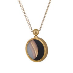 Ouroboros White and Black Agate Pendant Set in Gold with a Handmade Gold Chain