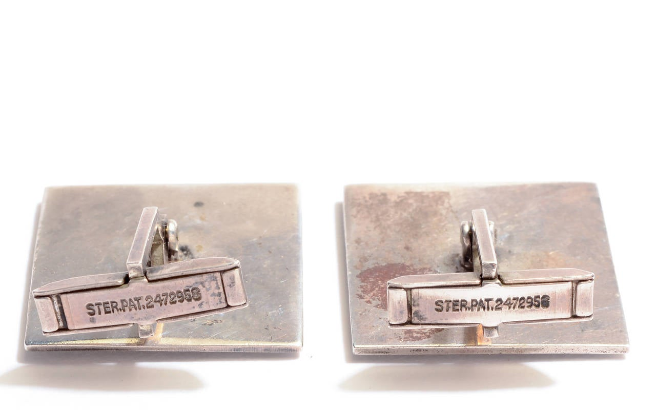 Charming sterling silver cufflinks for the male or female sailor. They cleverly convey the boats and water while reducing them to their most basic elements. The boat and water are applied on an oxidized ground.  Measurements are 15/16