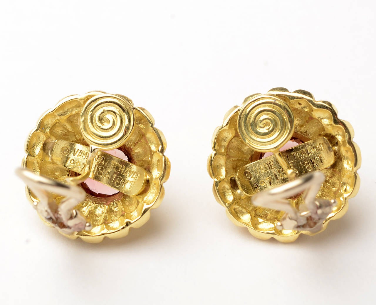 Tiered scallop design earrings centered with tourmaline  by Vahe Naltchayan. They are 18 karat gold with 14 karat white gold omega backs. They measure 5/8