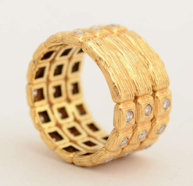 Stylish gold ring with 36 squares centered with brilliant cut diamonds weighing approximately 1 carat. The band is 7/16